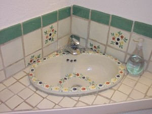 Bathroom's small but charming with hand-painted sink & Mexican tiles.