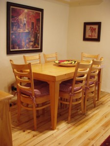 A joyful place to eat. Solid wood dining table seats 4.