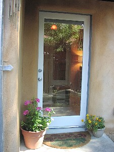 Lower the door shade if the geraniums get too nosy.