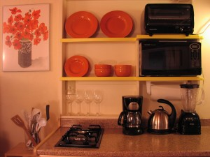 Appliances pose in the kitchenette. The salad spinner is too shy.