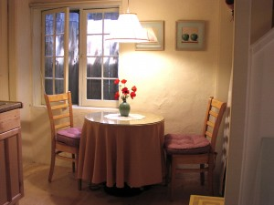 Dine by the window on chairs with comfy cushions.